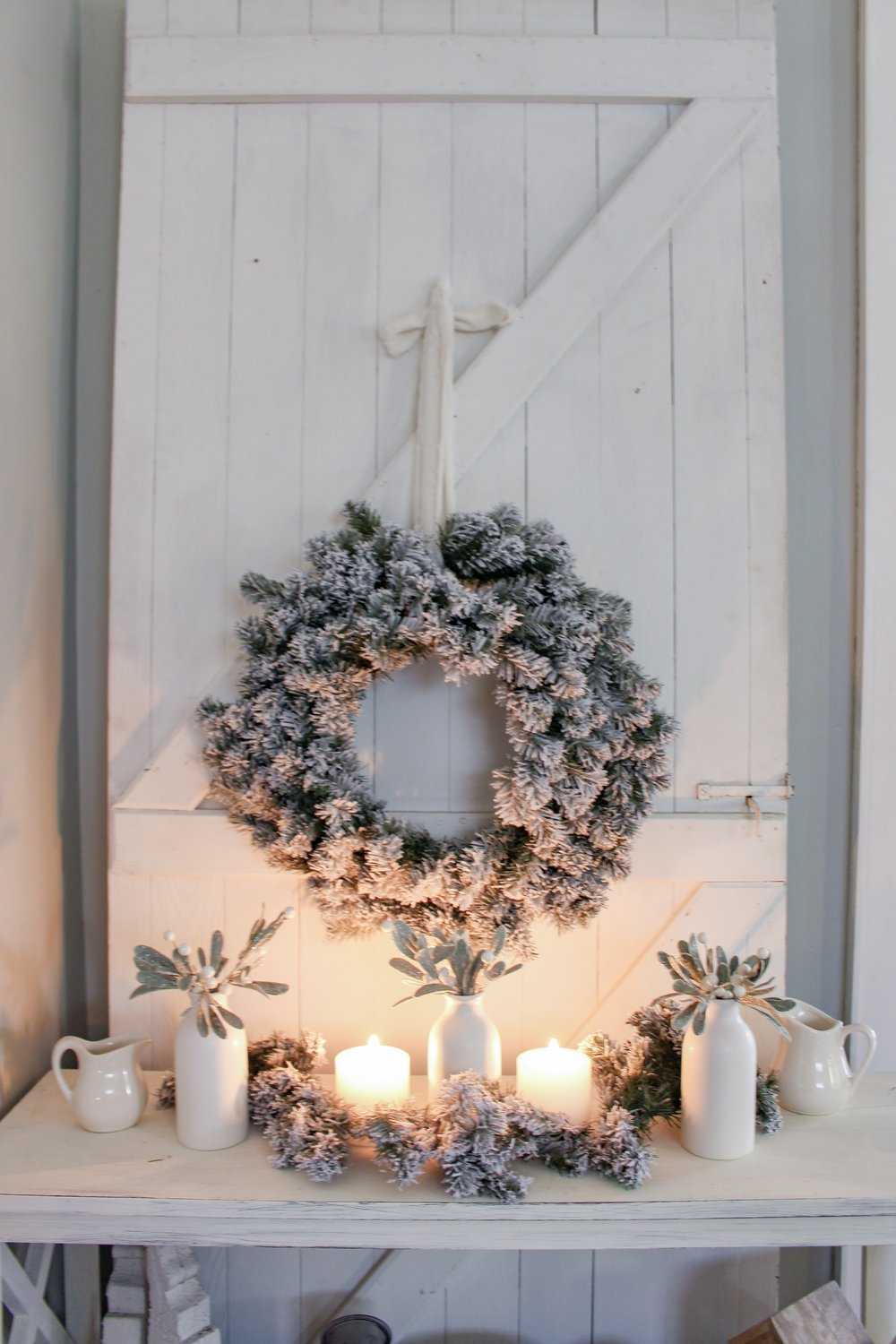 Flocked Wreath on barn door for Christmas