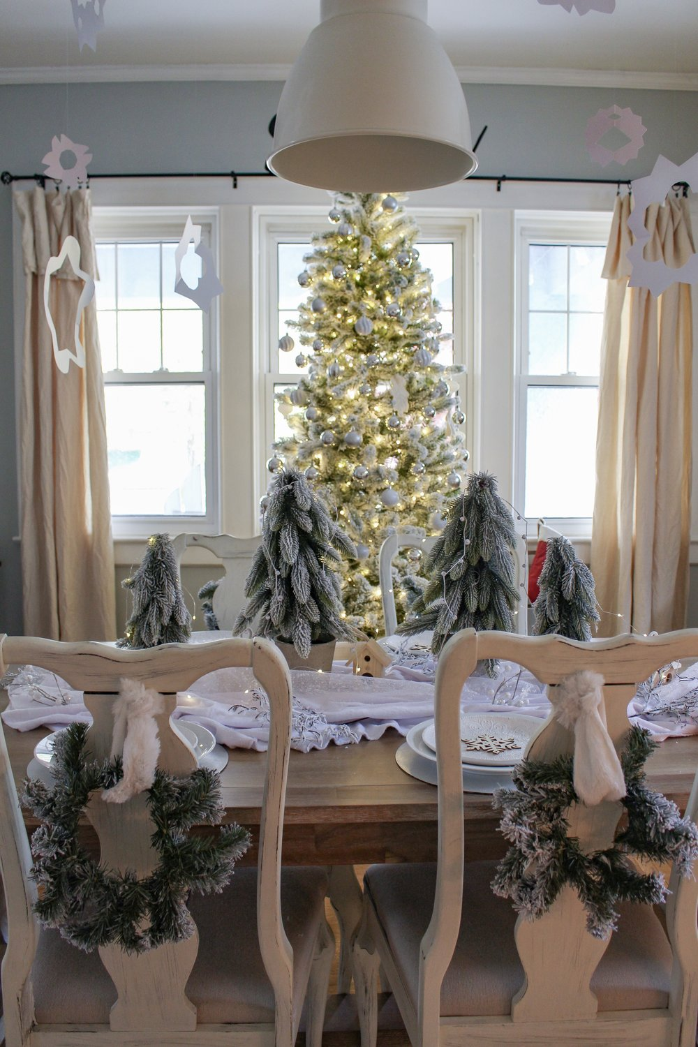 Christmas Wreaths on Dining Room Chairs