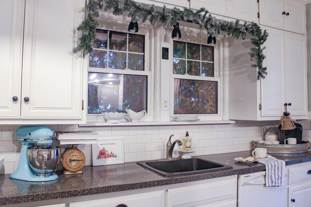 Christmas garland around the kitchen window