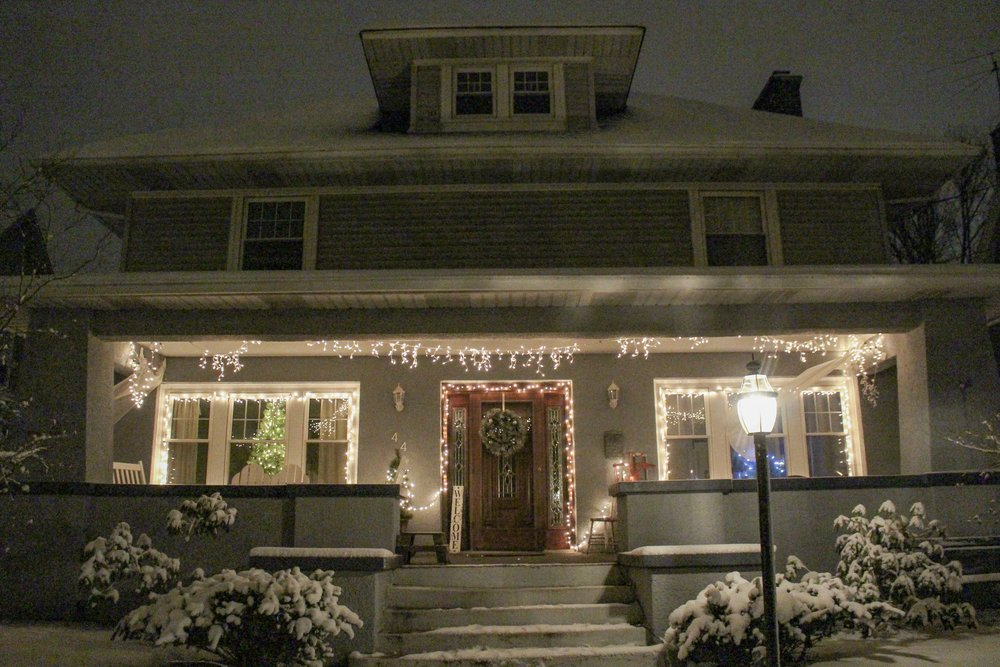 Christmas decor at night on the porch