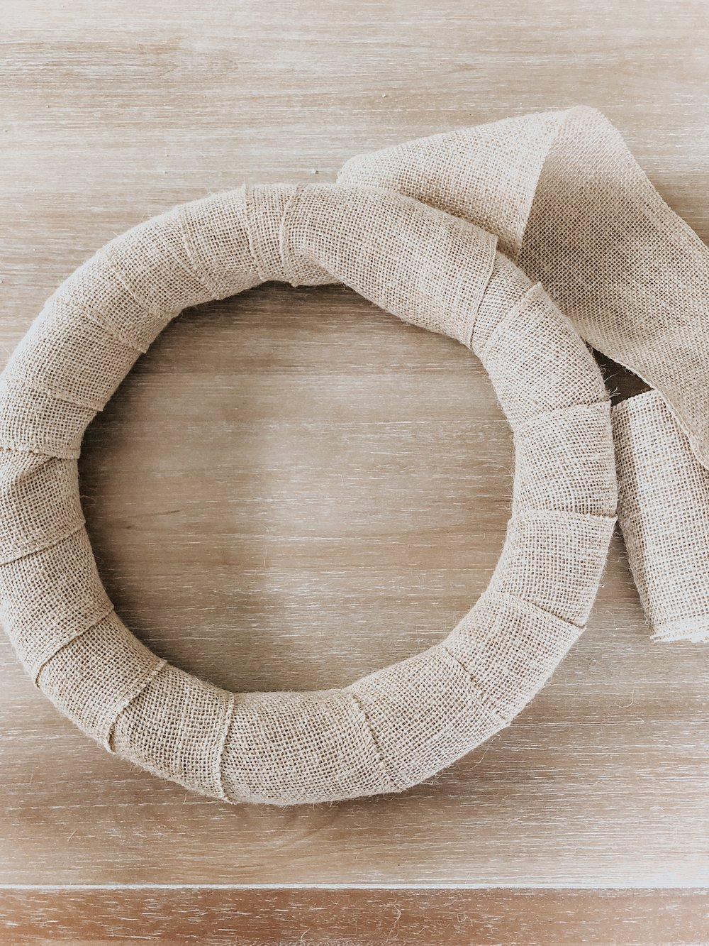 Wreath wrapped with burlap
