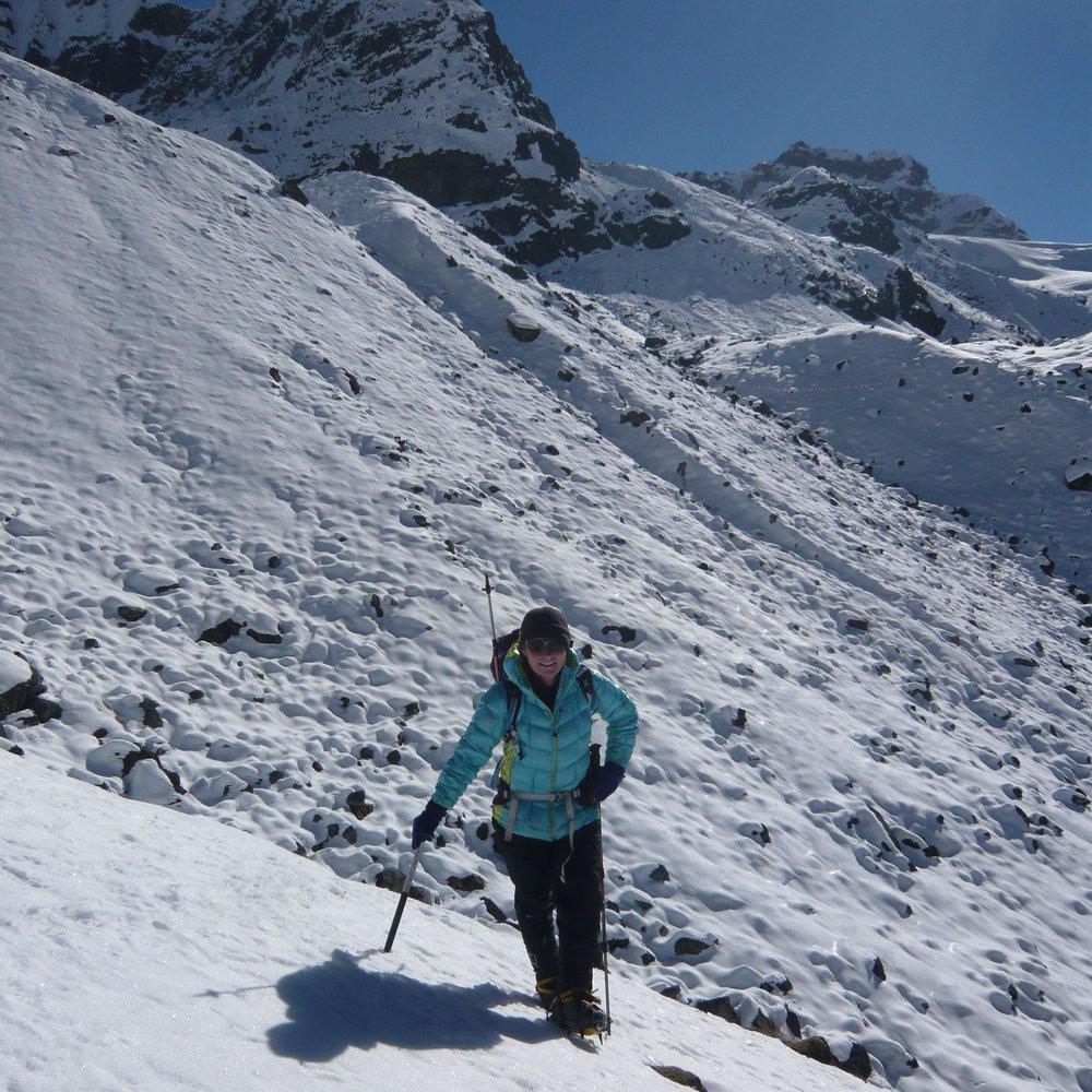 Pro mountaineer Adele Penningto using an axe in Nepal