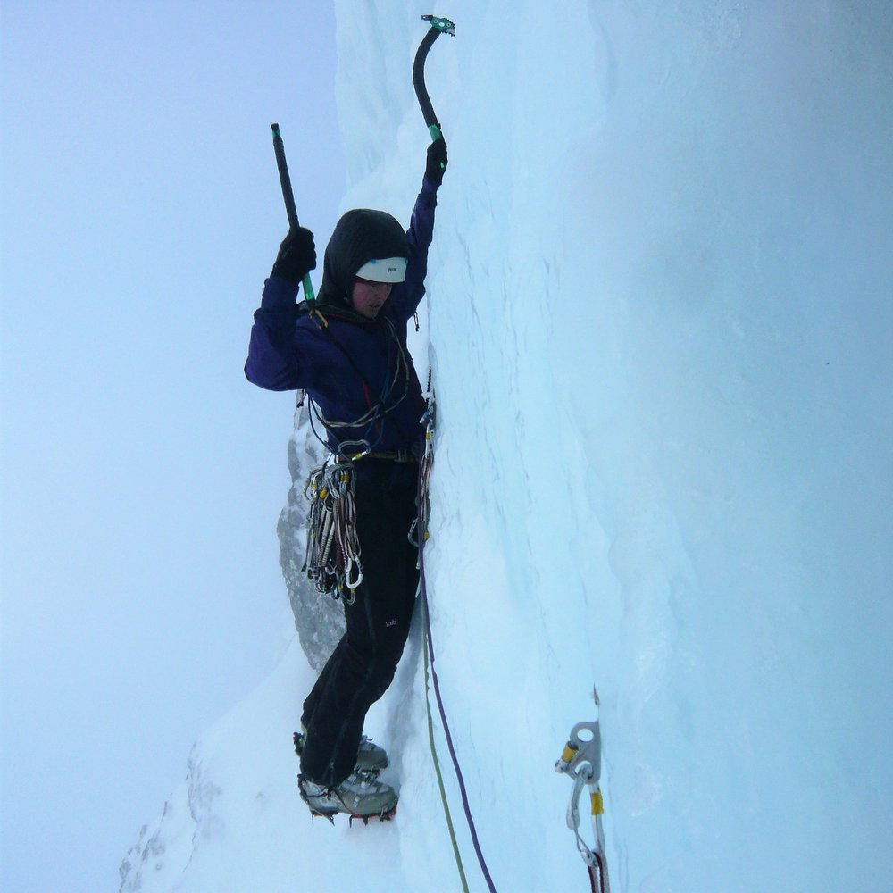 Becky Coles using springer leashes on steep ice in Scotland