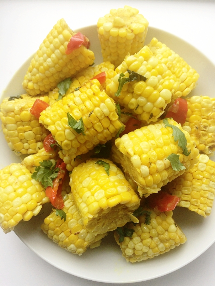Seasoned corn boiled in coconut milk and a curry gravy that's so addictive and the best appetizer or side dish for your summer BBQ. A sure crowd pleasing recipe. Check it out on the blog - Fruit Veggie Struggle.