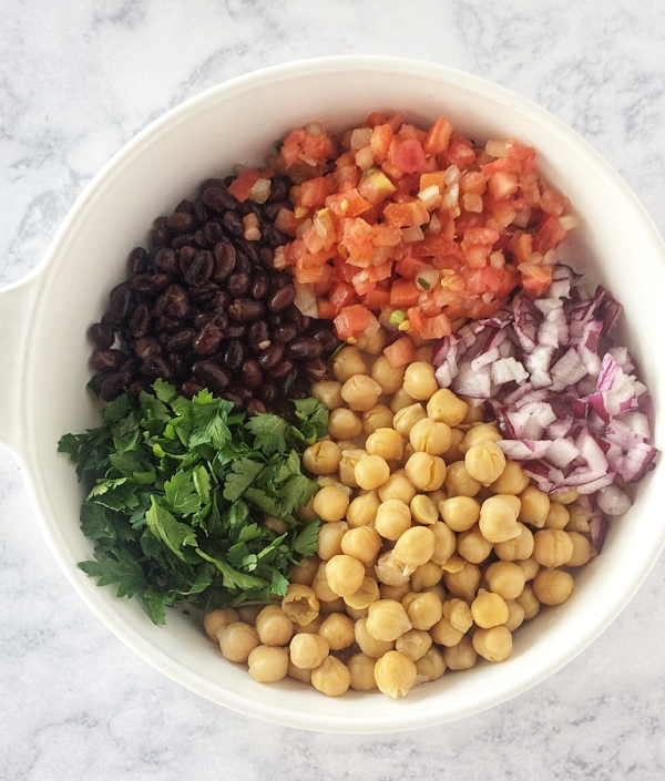 This cold chickpea salad makes a fast, frugal vegan lunch idea that is full of flavor and can be made in less than 10 minutes. Chickpeas, black beans, parsley, and red onions go perfectly together in this Mediterranean style salad.