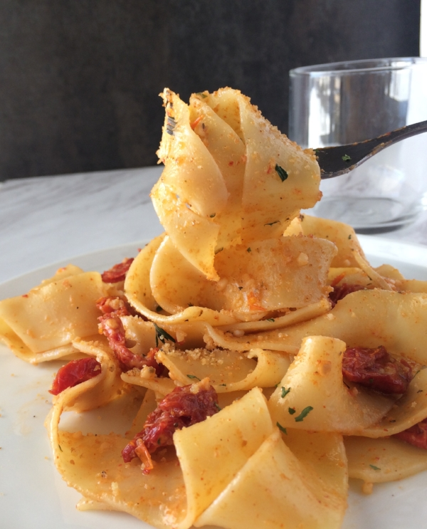 Beautiful Papardelle pasta tossed in a creamy sauce, with sun dried tomatoes. A quick meal you'll get on the table in less than 20 minutes.