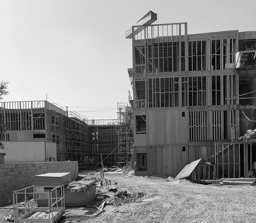 - As framing for Palo Verde Apartments tops off at 3 & 4 stories, the building solidifies its presence at the street corner in front, and begins to define the outdoor spaces in the back.