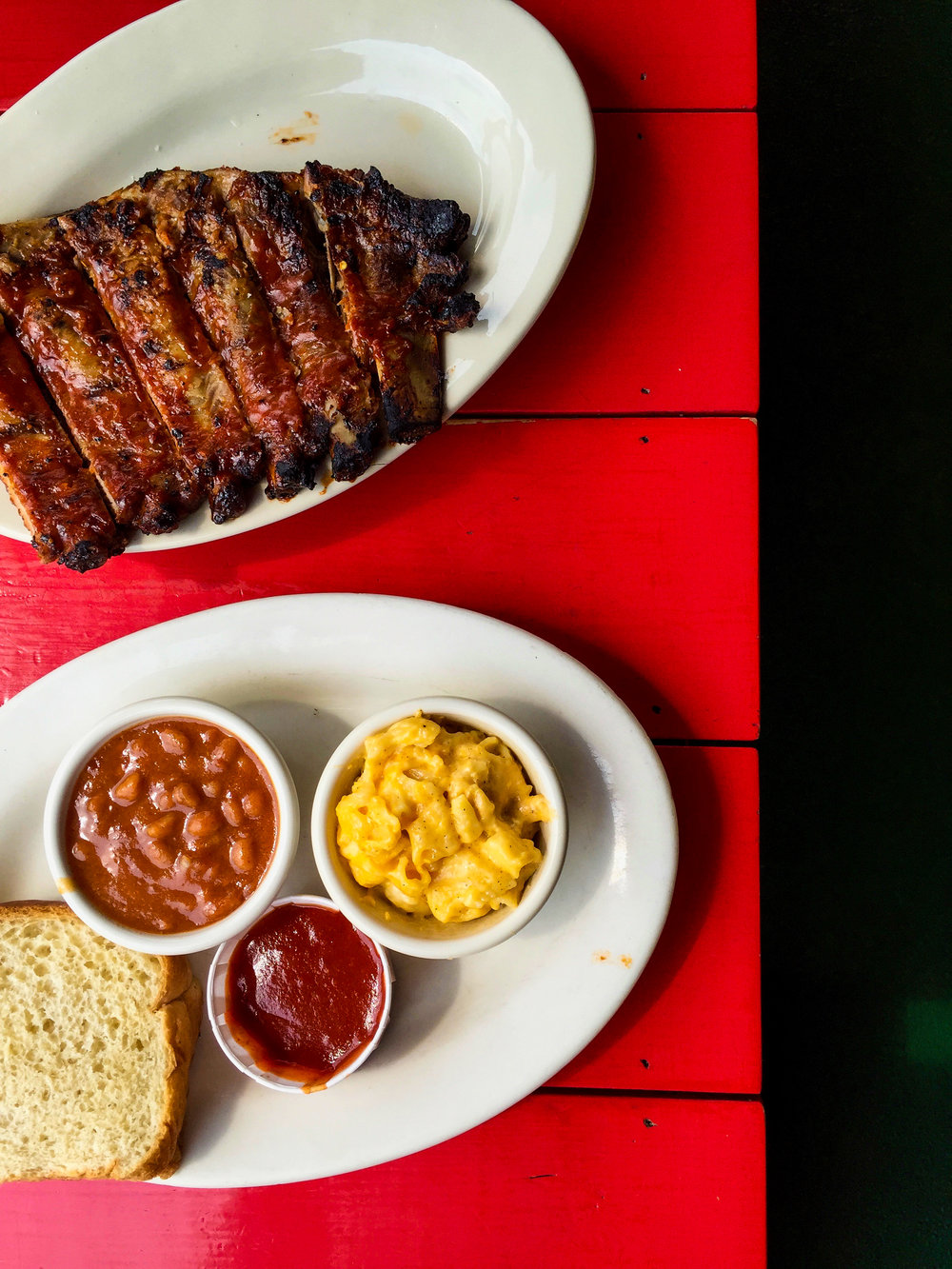 Half Rack Rib Plate from Fox Bro's - St Louis Style Rib served on white bread w/two sides.$19.00