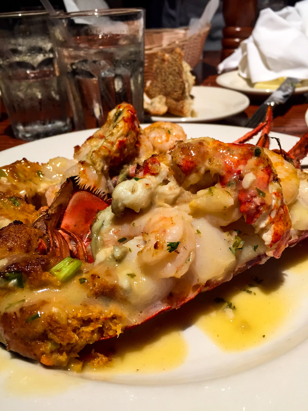 Stuffed Lobster Tail from Atlanta Fish Market - Maine lobster tail stuffed with lobster, shrimp scampi, scallops, honey-mustard aioli & drawn butter.$47.95