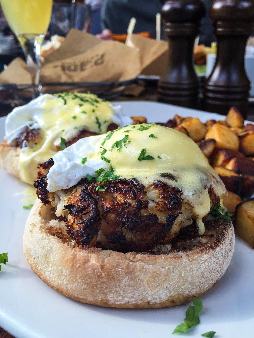 Crab Cake Benedict from Joe's American Bar & Grill - Lump crab meat, poached eggs, hollandaise sauce, home fries.$21.00