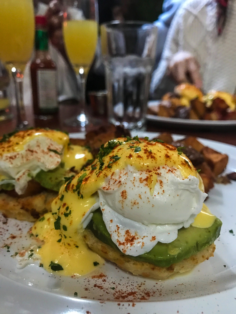 Avocado Benedict from Terra Firma - Poached eggs, crab cake, hollandaise, rosemary potatoes, biscuit, mixed greens.$12.00 for entree - $27.00 for bottomless (90 min. limit)