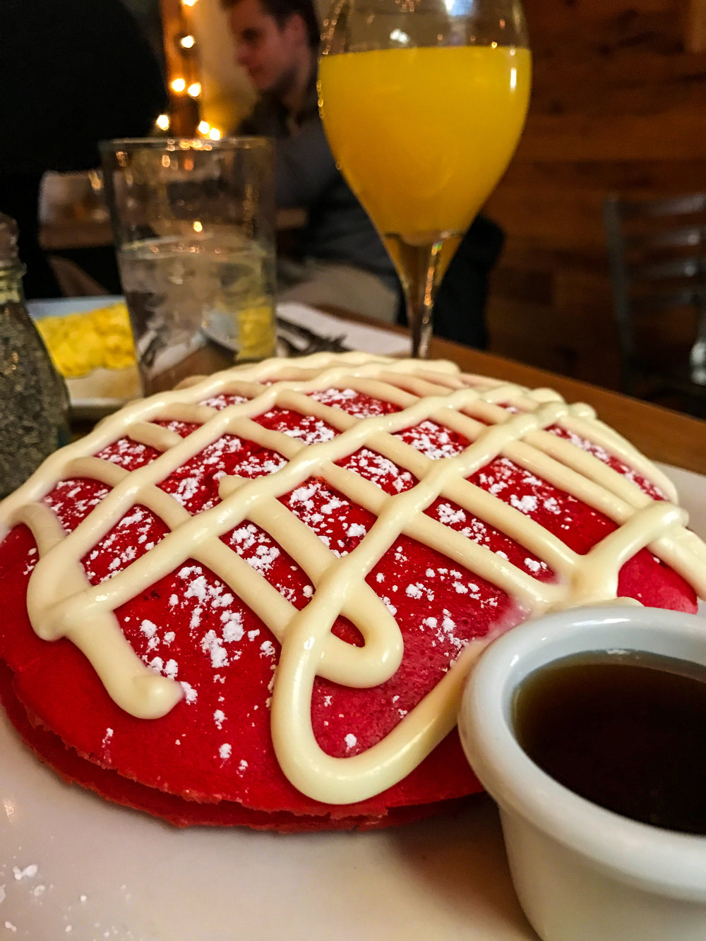 Red Velvet Pancakes from Two Door Tavern - Cream cheese icing & butter, maple syrup.$15.95 for entree & drink - $24.95 for bottomless (90 min. limit)