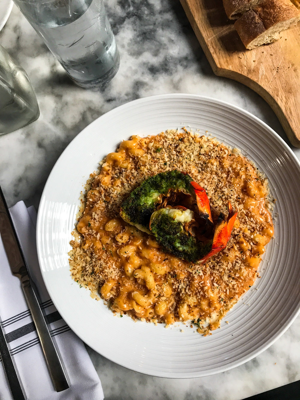 Lobster Mac & Cheese fromThe Artisan House - Poached Maine Lobster, Cavatappi Pasta, Parmesan Cheese, Aged White Cheddar Cheese, Mozzarella Cheese, Panko Bread Crumbs.$20.00