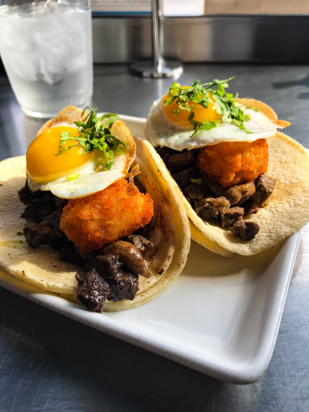 Loco Modo Tacos from Komodo - Hawaiian seared Angus ground beef patty, green onions, pineapple teriyaki sauce, white rice & sunny-side up egg.$3.45 each