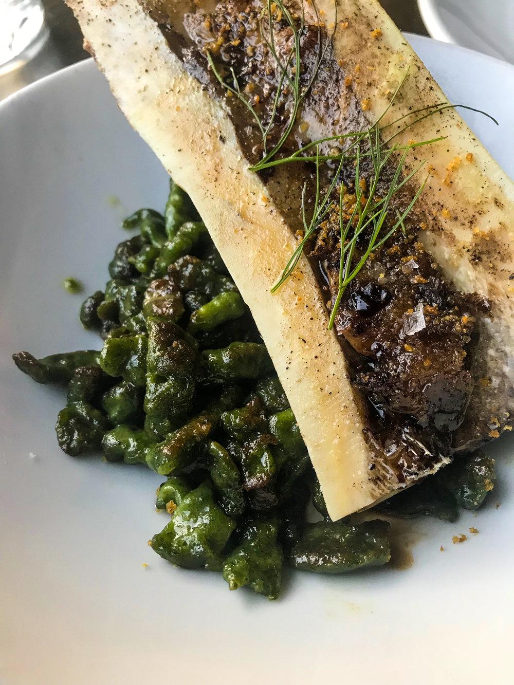 Roasted Marrow Bone from Bestia - Spinach gnocchetti,crispy breadcrumbs,aged balsamic.$19.00