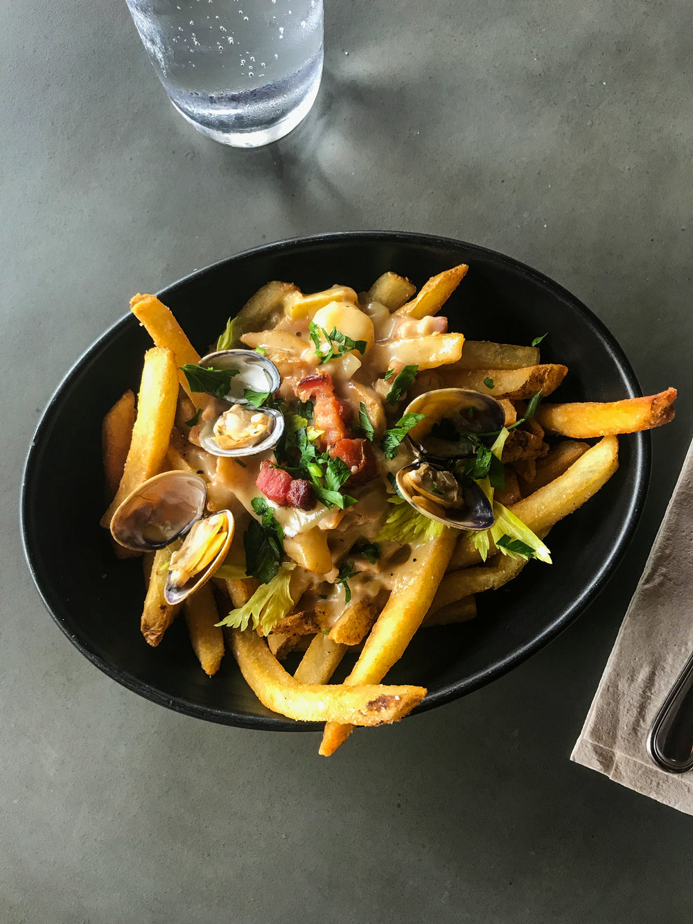 Chowder Fries from Plan Check - Housemade clam chowder, thick cut bacon, steamed little neck clams, celery.$12.00