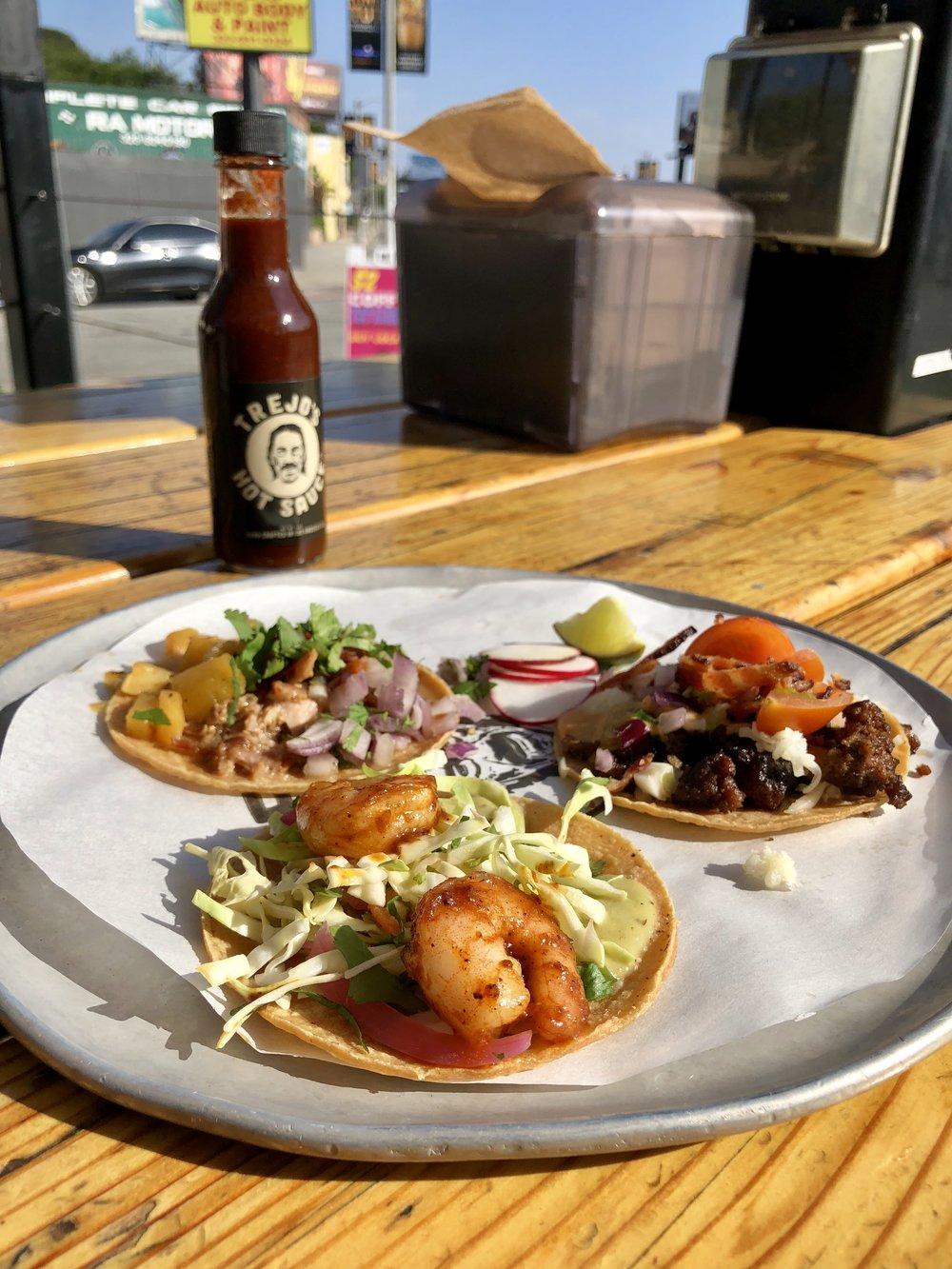 Taco Tuesday at Trejo's Tacos - Carnitas taco, spicy shrimp taco, cheeseburger taco.$2.50 each on Tue.