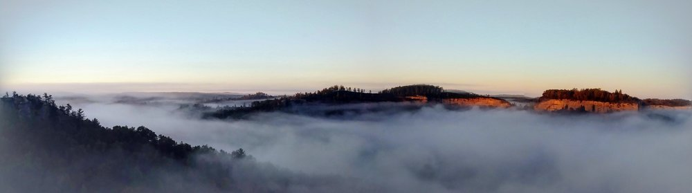 An amazing sunrise view of Pinch 'em Tight from Chimney Top Rock.