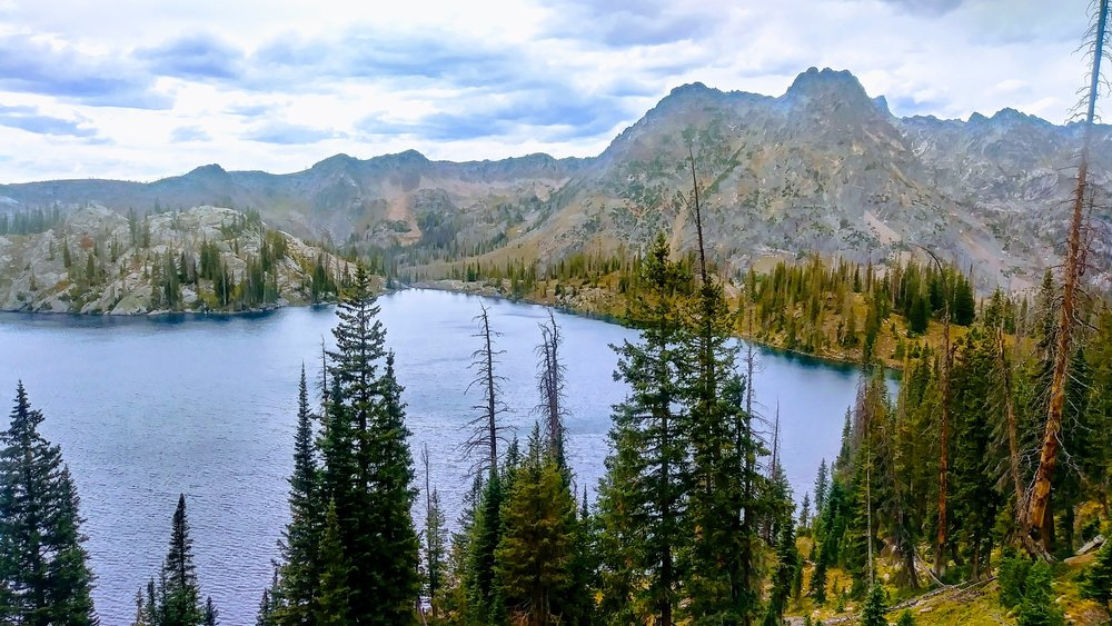 Gilpin Lake highlights this loop hike with cobalt blue waters surrounded by rugged mountains