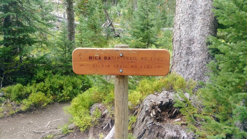 Trail sign at intersection of Gilpin Lake Trail and Mica Basin Trail