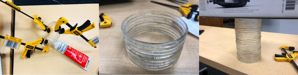 After applying some silicone sealant, we use bar clamps to secure acrylic rings tightly together to prevent movement.  Finally we used a box to add inward pressure to the entire body.