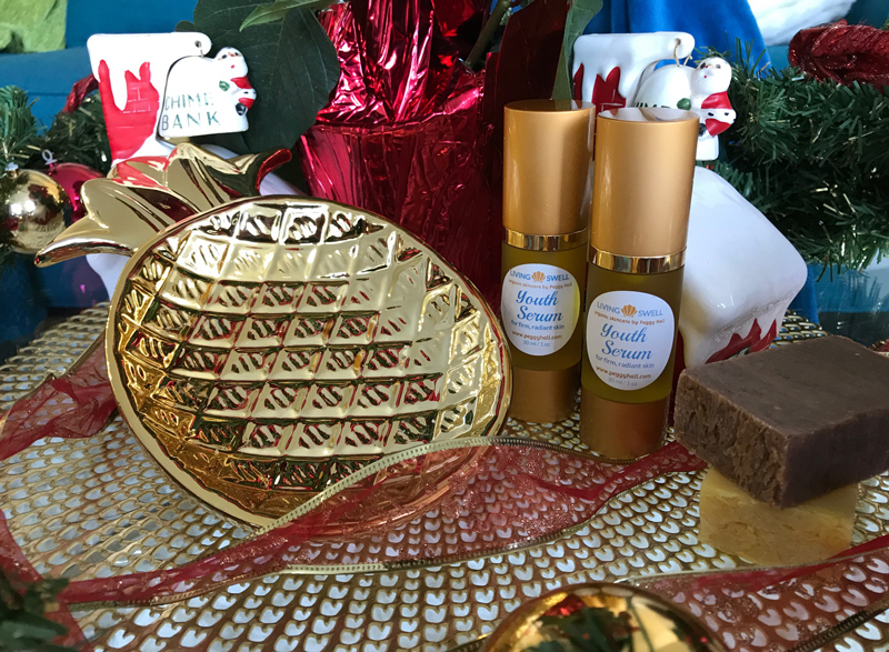 Gold-tone ceramic pineapple dish, two full-size youth serum and two 2-ounce bars of handmade soap (lavender-VanillA and California Sunshine)