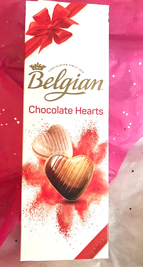 Indulge in these delicious heart-shaped milk and dark belgian chocolates filled with praline cream
