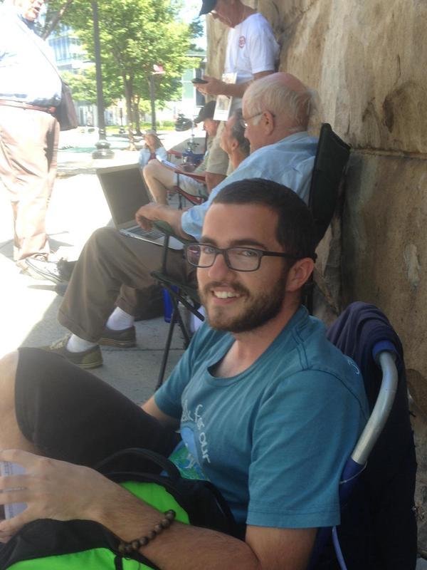 Lee Stewart, hunger strikers seek shade across the street from FERC