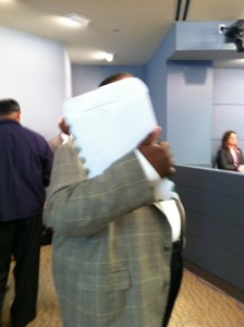 Former taxi chair Leon Swain, who's permitted to wear a gun, refused to say whether he was at the Jan. 30 hearing, and blocked TheFightBack's attempt to take his photo.