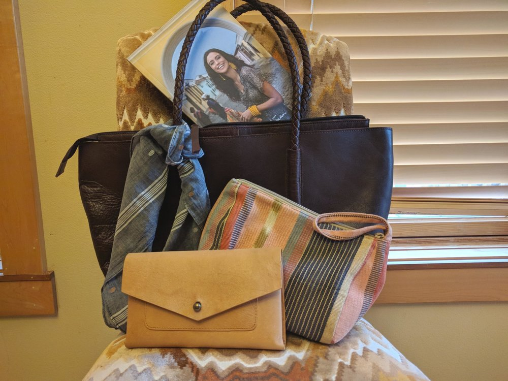 How to keep your purses organized. Pictured: Noonday Collection's fair trade Arcadia Bag, Jamdani Scarf, Rustic Leather Wallet, and Drifter Makeup Bag.
