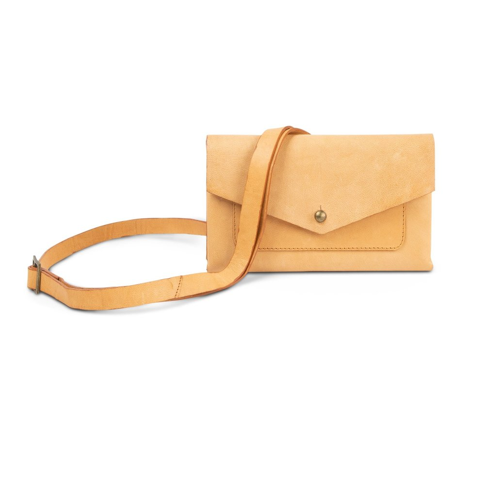 Noonday's fair trade, ethically sourced Rustic Leather Wallet has a removable strap to convert it into a crossbody or a belt bag.