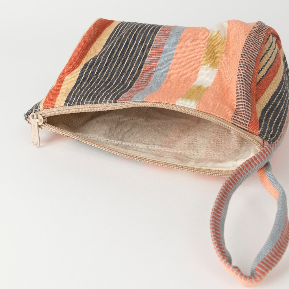 Noonday Collection's Drifter Makeup Bag is the perfect size for either an in-purse pouch to contain the little essentials, or a standalone clutch.