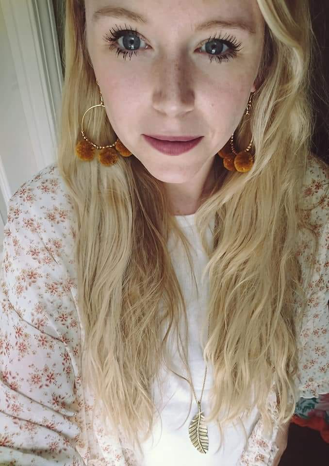 Ambassador Alex Polk is rocking the playful Marigold Hoops with a long pendant, the Plumage Necklace.