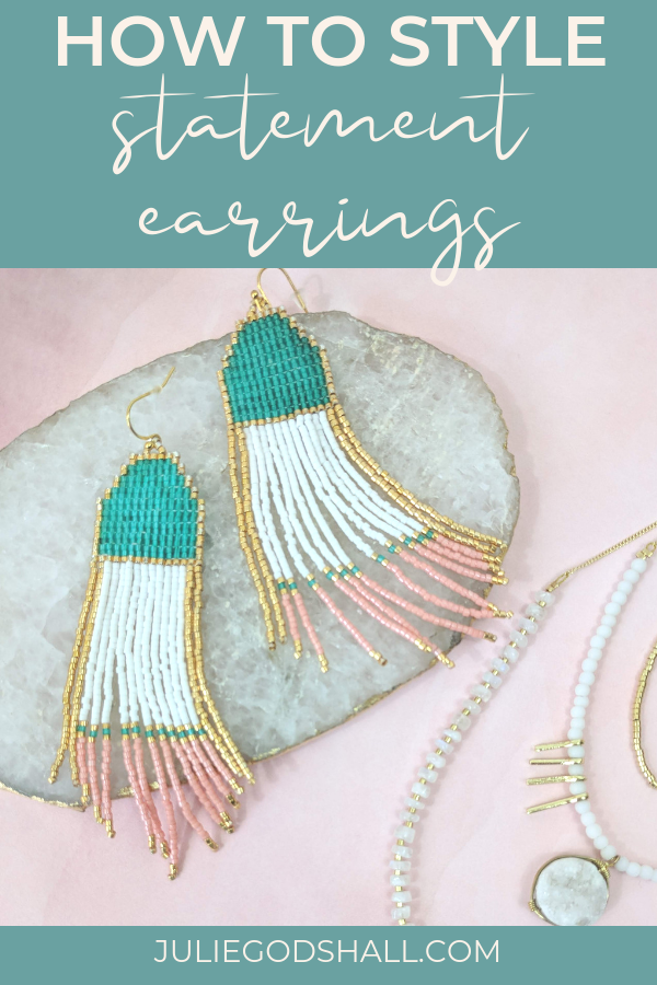 How to style statement earrings with other jewelry (slide show). Pictured: Noonday Collection's fair trade Summer Skies Earrings, Aurora Necklace and Gilded Stone Tray. #noondaystyle #fairtrade #noondaycollection