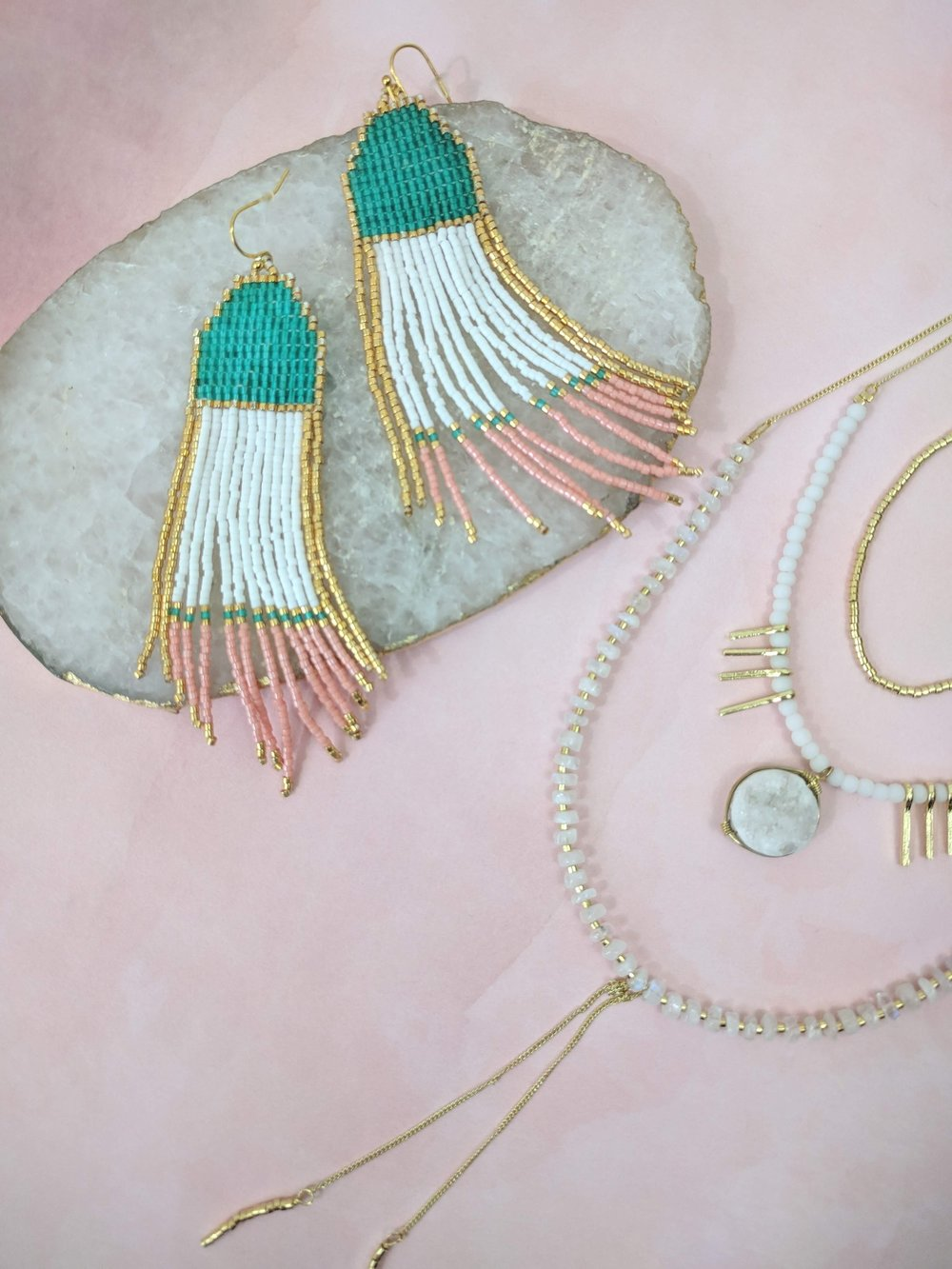 How to style big earrings with other jewelry (slide show). Pictured: Noonday Collection's fair trade Summer Skies Earrings, Aurora Necklace, and Gilded Stone Tray. #noondaystyle #noondaycollection