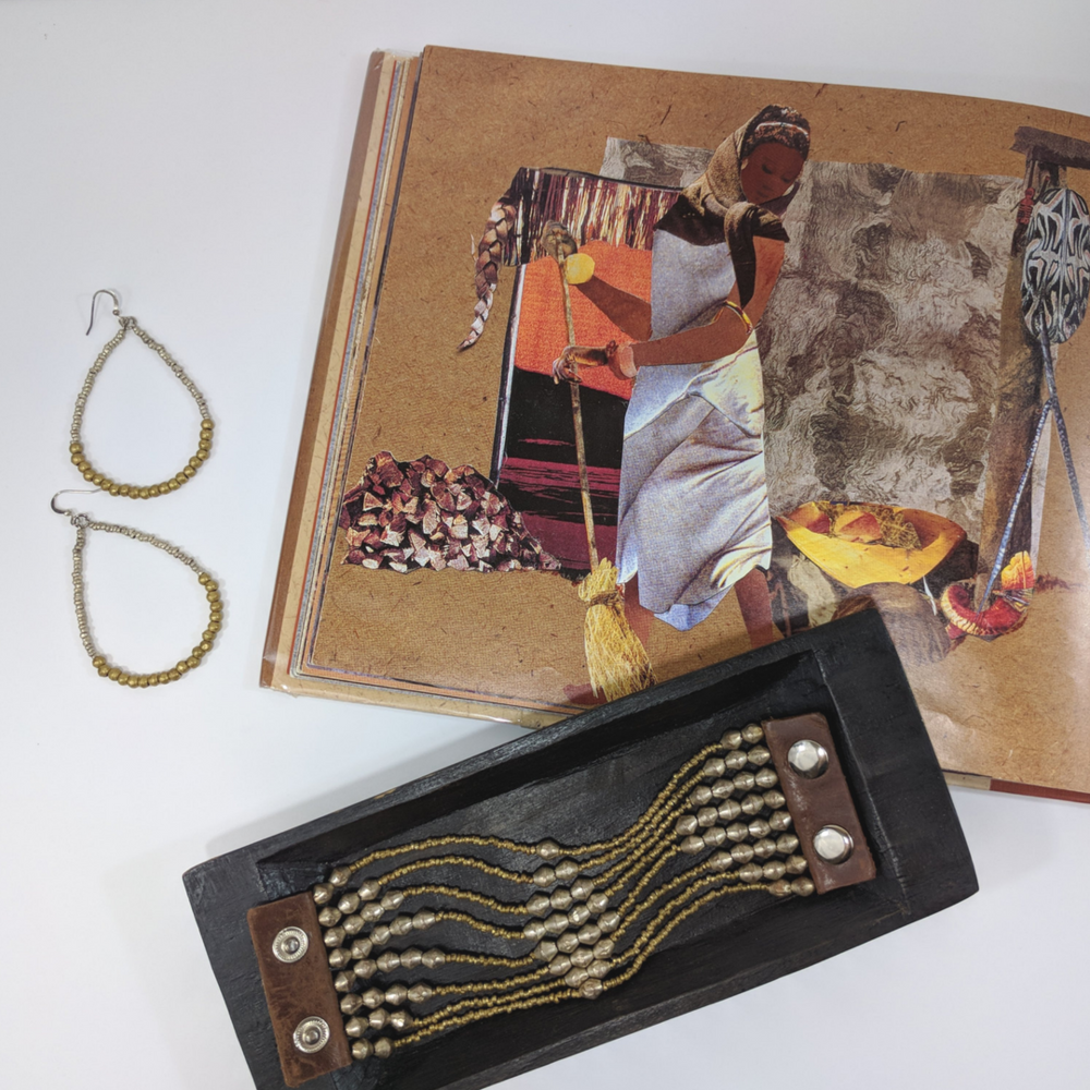 Diverse children's books that connect kids to countries around the globe, featuring Noonday Collection's partner countries. Pictured: The Lion's Whiskers, a folktale from Ethiopia, pictured with artillery jewelry. #noondayambassador #childrenslit #kidslit #diversebooks