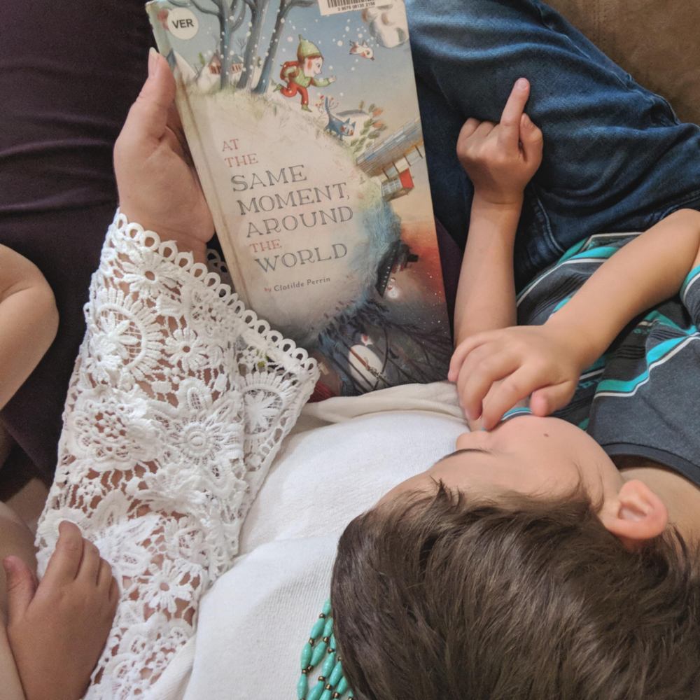 Diverse children's books that connect kids to countries around the globe, featuring Noonday Collection's partner countries. Pictured: At the Same Moment, Around the World by Clotilde Perrin. #noondayambassador #childrenslit #kidslit #diversebooks