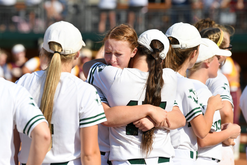 Members of the Normangee softball team comfort one another following their loss to Bells in the Class 2A state championship Thursday, May 31, 2018, in Austin, Texas. (Laura McKenzie/The Eagle)