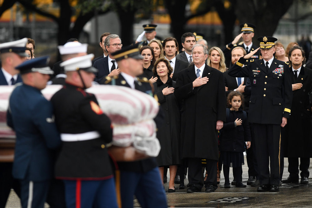 Former President George W. Bush, former First Lady Laura Bush and other members of the Bush family look on as the casket of former President George H.W. Bush is carried from the funeral train to a waiting hearse on Thursday, Dec. 6, 2018, in College Station, Texas. (Laura McKenzie/The Eagle)
