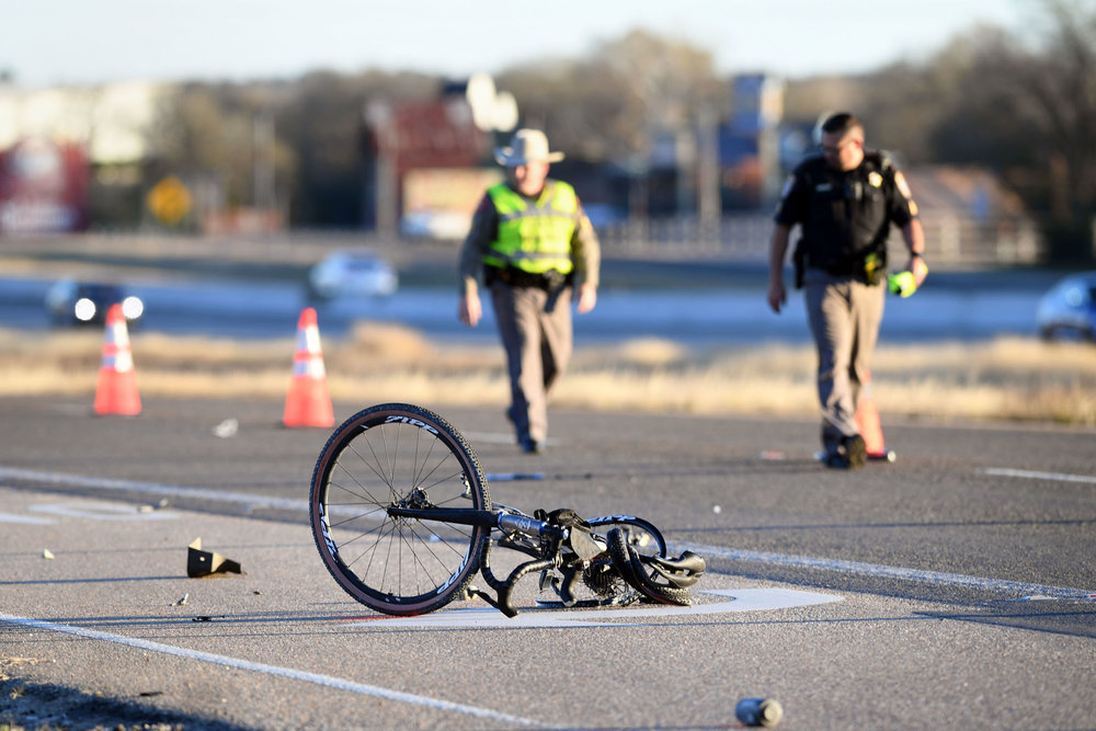 A damaged bicycle lies in the Highway 6 northbound feeder road as the scene of a fatal accident near Peach Creek Cutoff is investigated Friday, Jan. 4, 2019, in College Station, Texas. The cyclist was killed after being stuck from behind by a motorist. (Laura McKenzie/The Eagle)