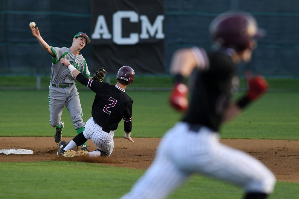 A&M Consolidated's Ty Hodge (2) is out at second base as Brenham's Garrison Weiss throws to first in the first inning Thursday, March 14, 2019, at Tiger Field in College Station, Texas. (Laura McKenzie/The Eagle)