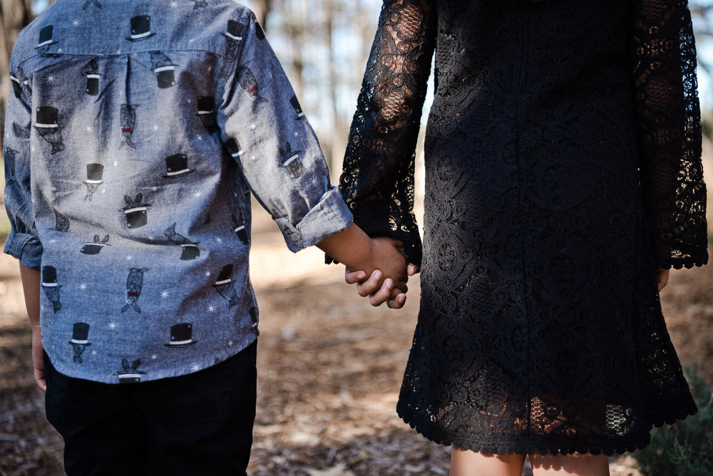 Little brother and big sister holding hands in Cedar Grove Park in Tustin, California. Full post at lisahuchen.com.