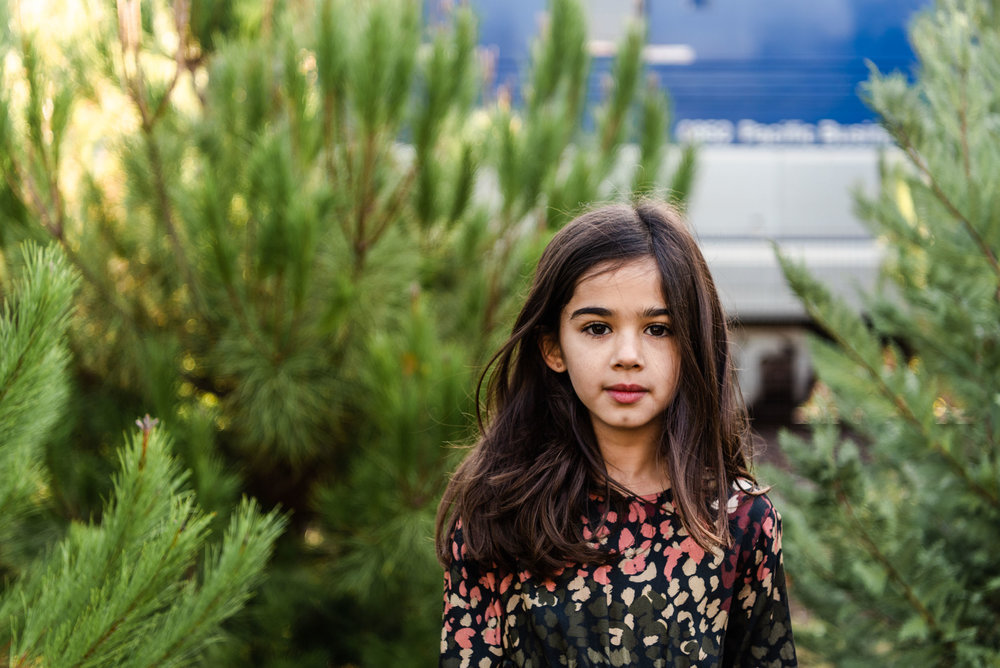Lisa Hu Chen orange county family photographer pretty young girl with dark hair in front of passing train in san juan capistrano #jacksforest