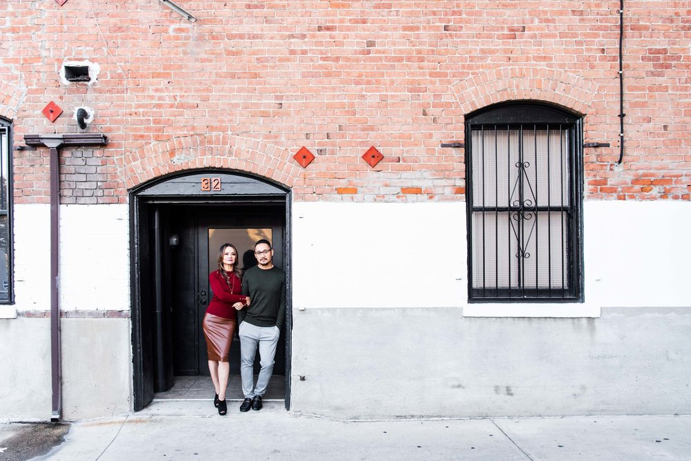 Lisa Hu Chen orange county family photographer | couple standing in the doorway in the alley off Chapman Avenue in Old Town Orange