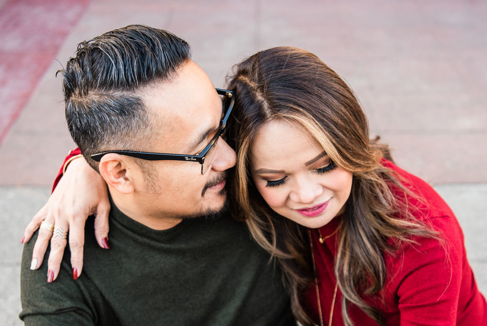 Lisa Hu Chen orange county family photographer | couple hugging and sitting on the curb in Old Town Orange