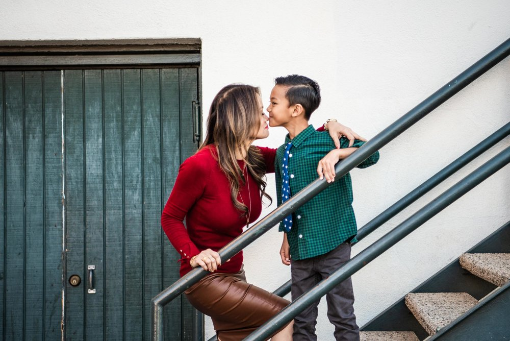 Lisa Hu Chen | mom and her son standing on the stairs next to a green door in Old Town Orange