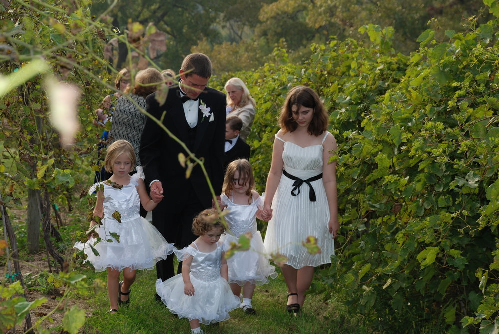 Groom with flower girls.jpg
