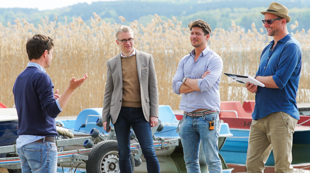 actor Jens Eulenberger talking to director of marketing & sales of A-ROSA Michael Lemke, producer Sebastian Deyle and creative director Andreas Knuffmann