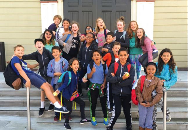 Millennium school children smile in a group shot