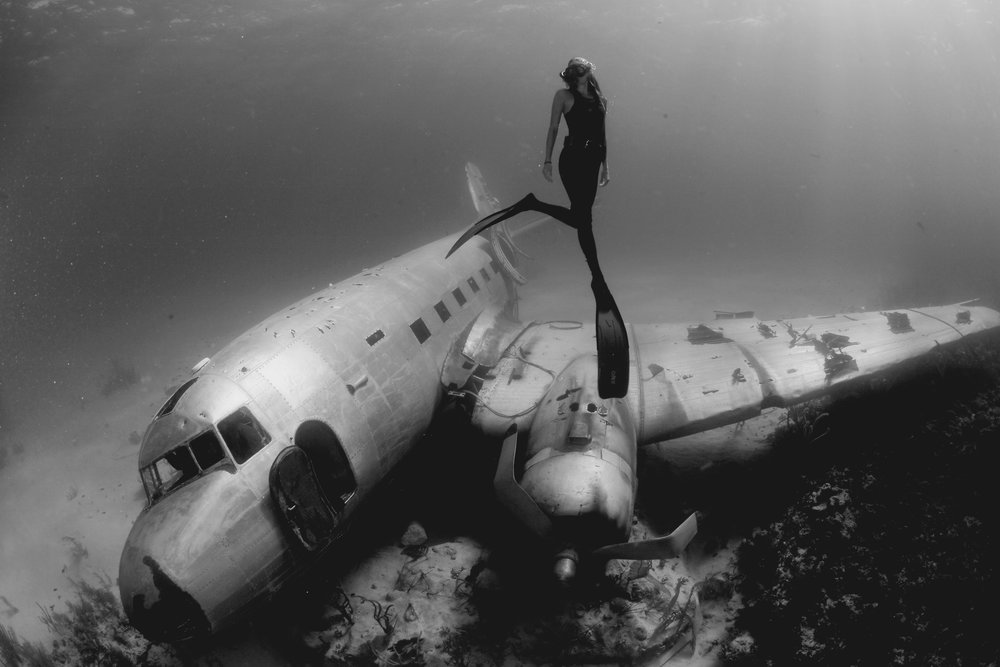Mehgan Heaney-Grier free diving around airplane